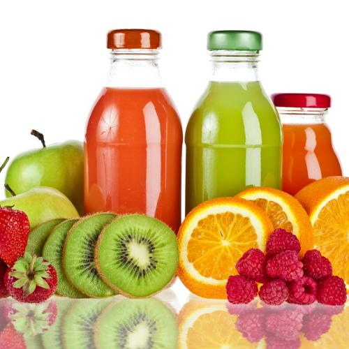 Juice bottles and fruit